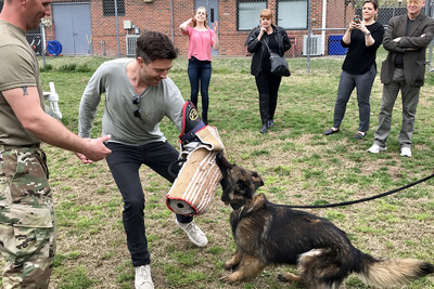 Photo of Actors Visit Military Working Dogs